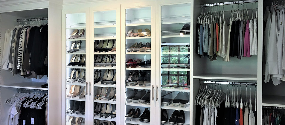 Angled shoe shelving with accent lighting in the side panels.
