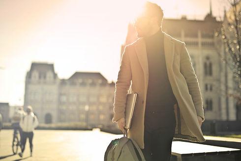 photo-of-man-wearing-brown-coat-842539.j