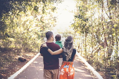 photo-of-family-walking-on-park-2880897.