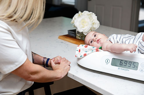 Lactation-consultation-weighing-a-baby