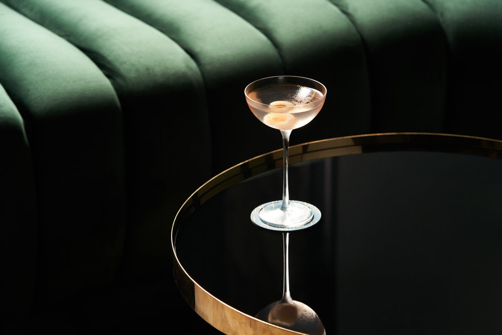 Classic cocktail glass on glass table in