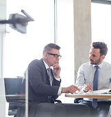 Two business meeting having a meeting at a desk