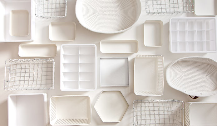 Flat lay of Marie Kondo's white storage