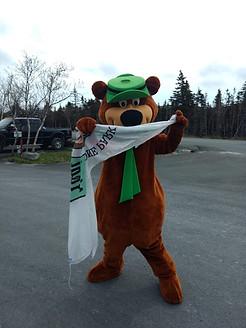 Yogi Bear helping raise the flag