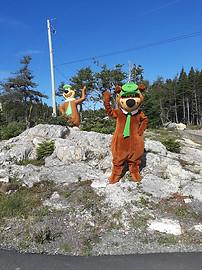 Yogi Bear posing with his statue