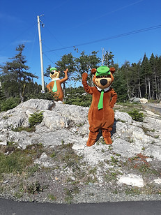 Yogi Bear posing with his statue