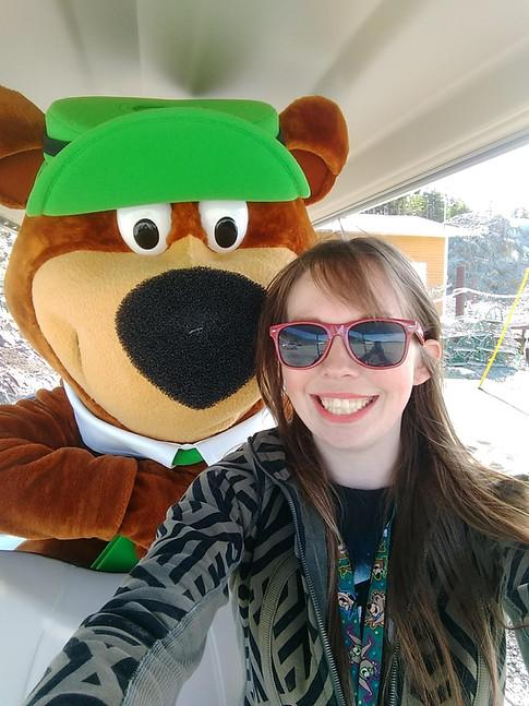 Yogi Bear going for a golf cart ride with Priscilla