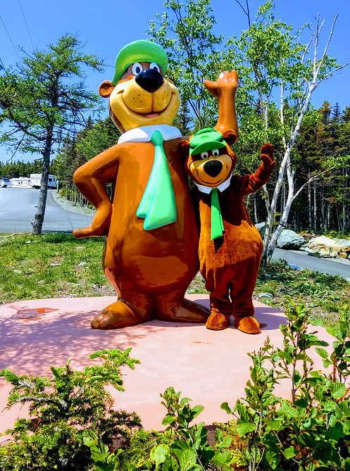 Yogi Bear mimicing his statue