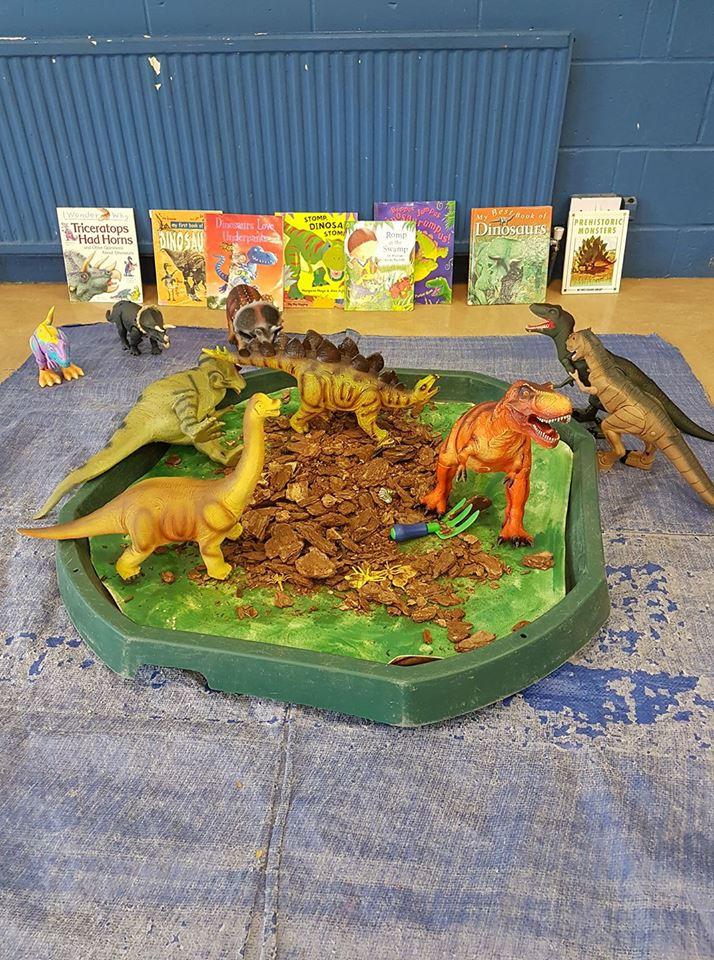 Barkham Preschool dinosaurs exploring the messy play area