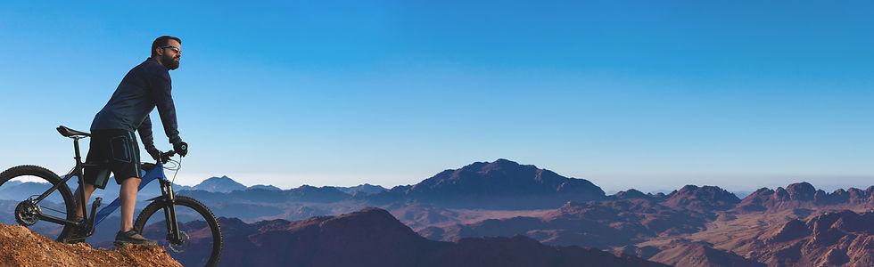 Man Biking Mountains Outdoors - iStock-1