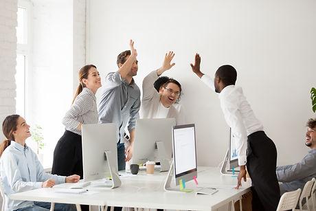 Happy multi-ethnic employees sales team