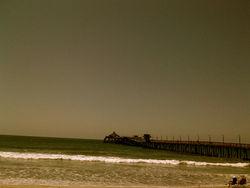 couple on shore, beside pier