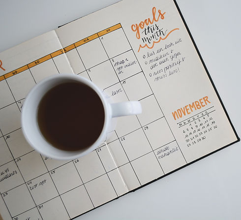 white%20ceramic%20mug%20with%20coffee%20on%20top%20of%20a%20planner_edited.jpg