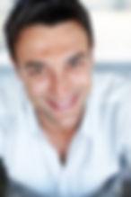 Canva - Happy man smiling.jpg
