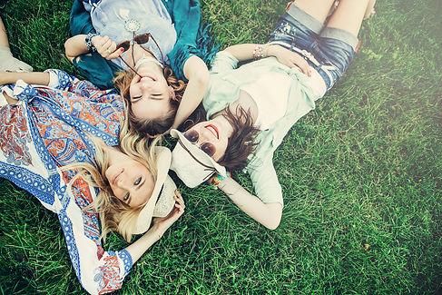 Trendy Hipster Girls Relaxing on the Gra