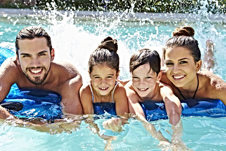 Portrait Of Family On Airbed In Swimming