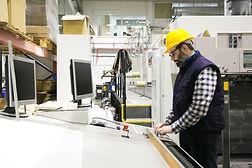 focused-male-engineer-in-glasses-operating-machine.jpg