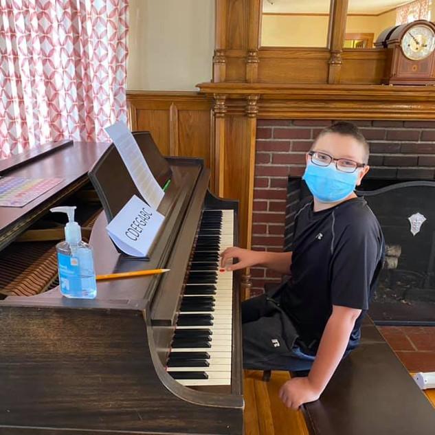 Ryan Marshall learning piano.jpg