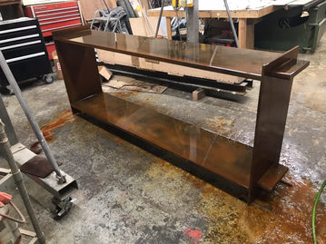 #626. CONSOLE w shelf, weathered steel (