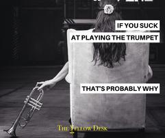 YellowFunniesSuckatTrumpet.png