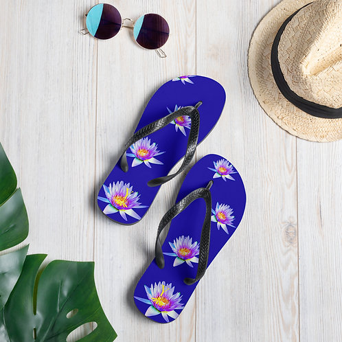 Little Lotus Flip-Flops flat lay with sunglasses
