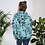 Roses and Bees Unisex Hoodie model back with plants