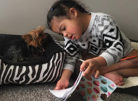 Zuri Reading To Tinkerbell