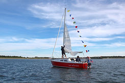Hoist the sail on a private sailboat