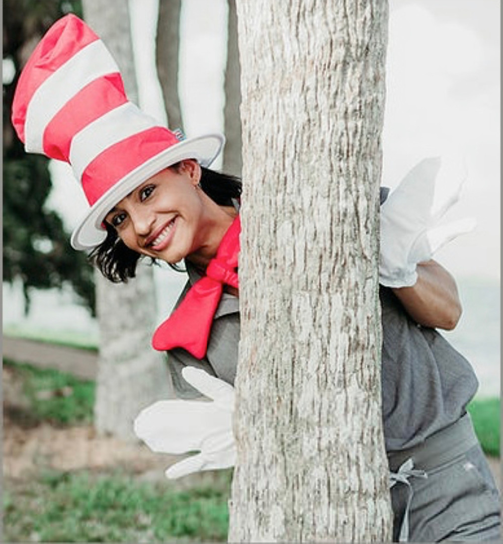 She is wearing a Cat In The Hat Costume