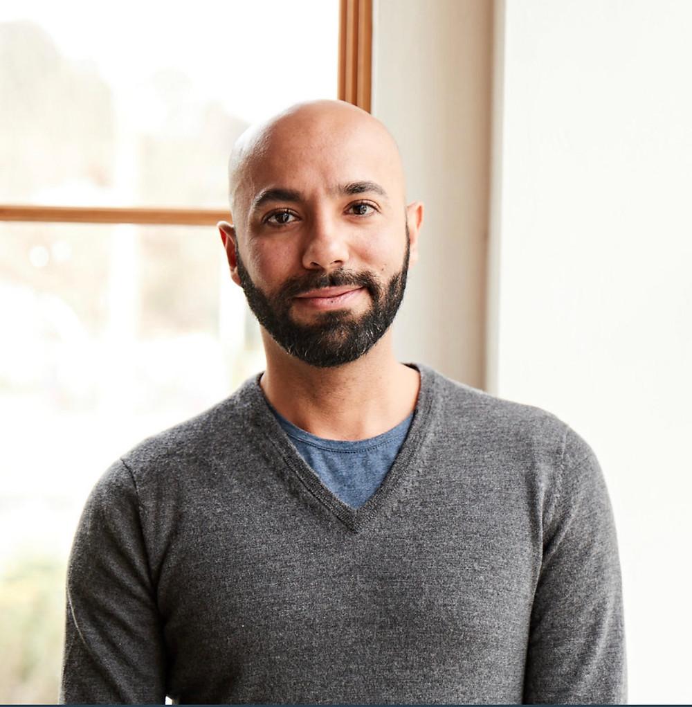 Dr. Nasser Mohamed in a grey sweater