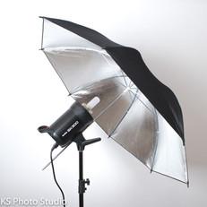 Paraguas plateado de rebote