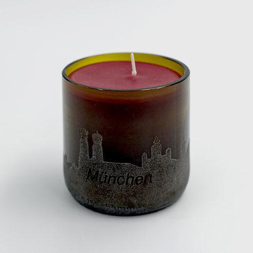 Kerze im Glas mit Münchenskyline