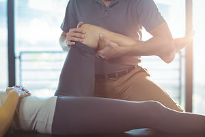 bigstock-Physiotherapist-giving-knee-th-