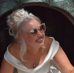Bride seated in pumpkin swing