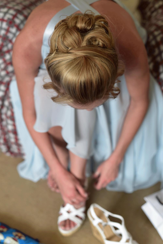 Bridesmaid prepares