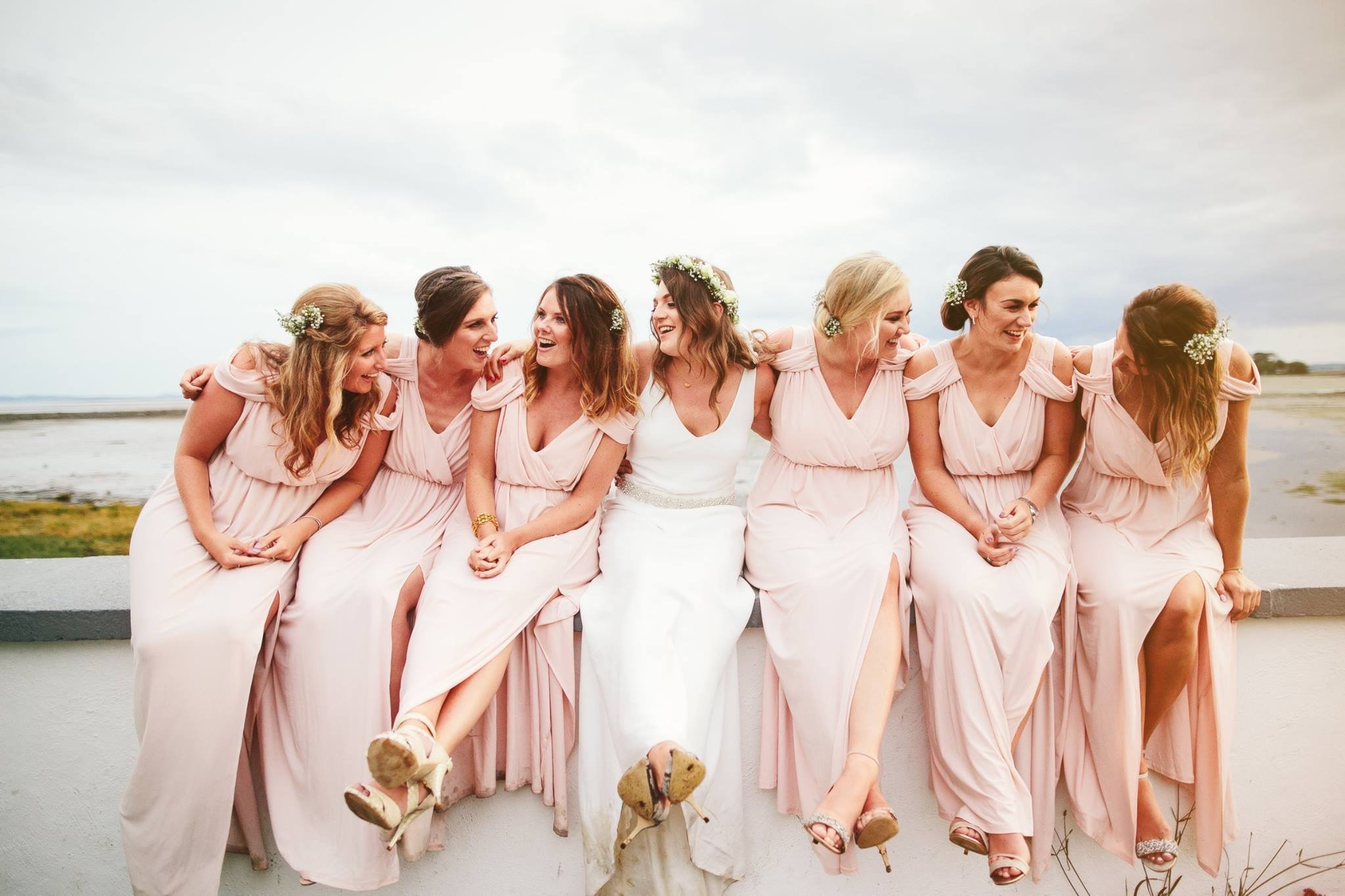 bridal party on wall