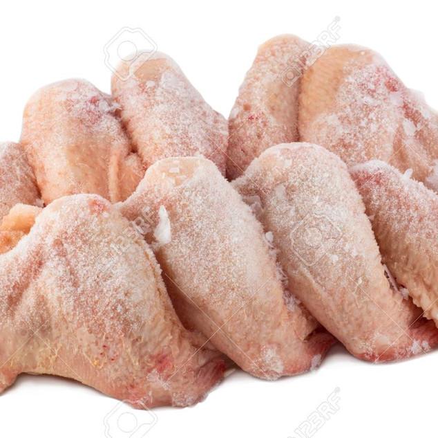 97947324-frozen-chicken-wings-white-back