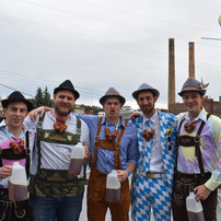Guys in german costumes with beer