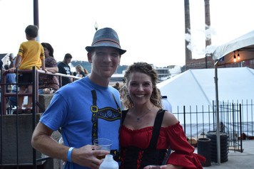 Couple in German costumes with beer