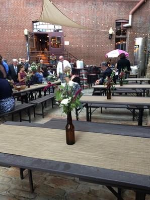 The Biergarten tables with beer bottle centerpieces
