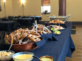 Table with pretzels and salad on it
