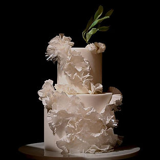Wedding cake with dramatic ruffles under