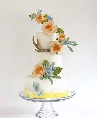 Custom Wedding Cakes by Wilson Custom Cakes in Jackson Hole Wy Sugar roses, Antler, Hydrangeas and delicate frills