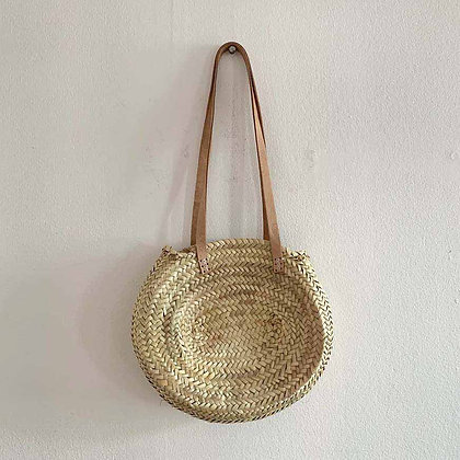 Small round straw bag with leather straps