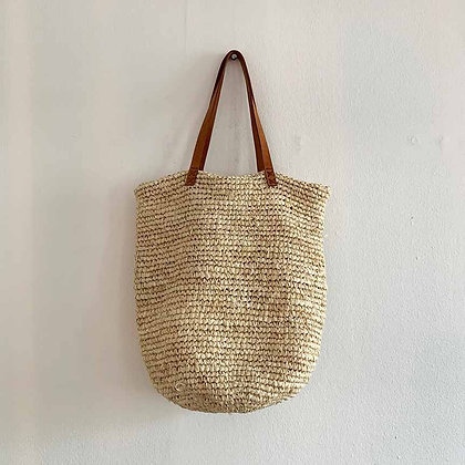 Long light straw bag with leather straps