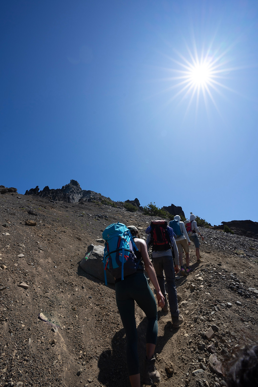Heading up the pile of choss and skree aka Mount Thielsen