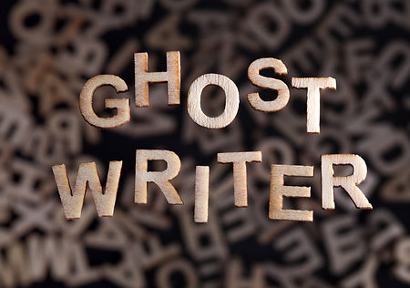 Ghostwriter text in wooden letters floating above random letters out of focus_edited.jpg