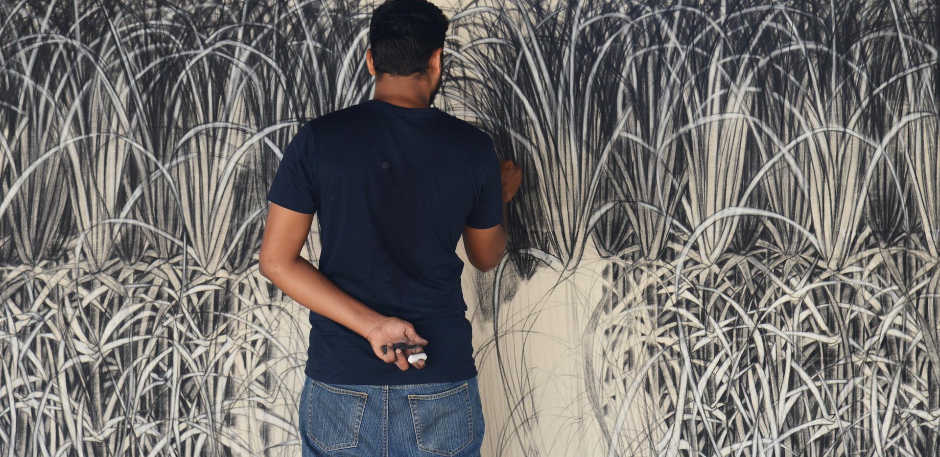 Dhiraj Pednekar creating his artwork onsite