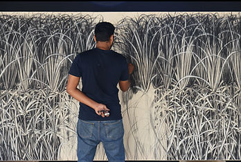 Dhiraj Pednekar creating his artowrk Bor
