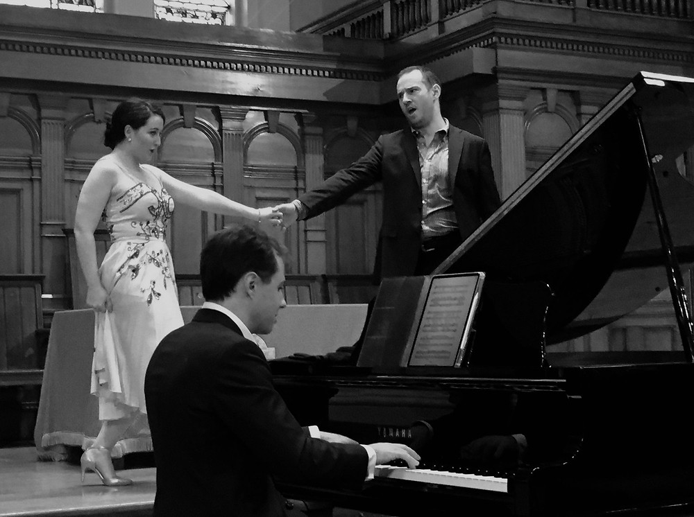 Singers and pianist perform in a concert